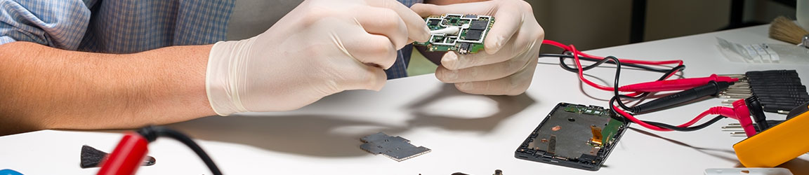 Electrical engineer working on a mobile device