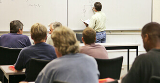Instructor teaching adult learners in a classroom