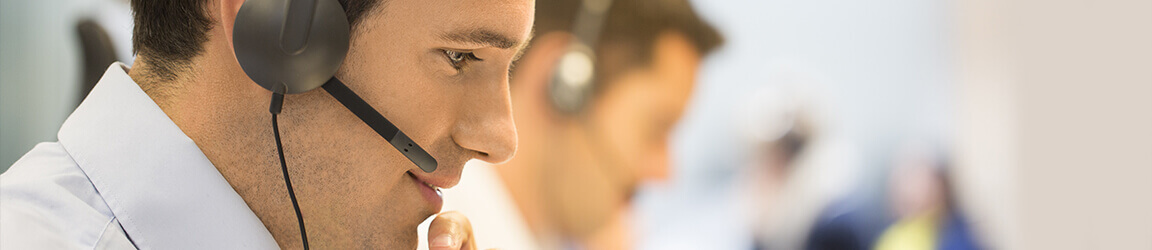 Male call center operator with headset