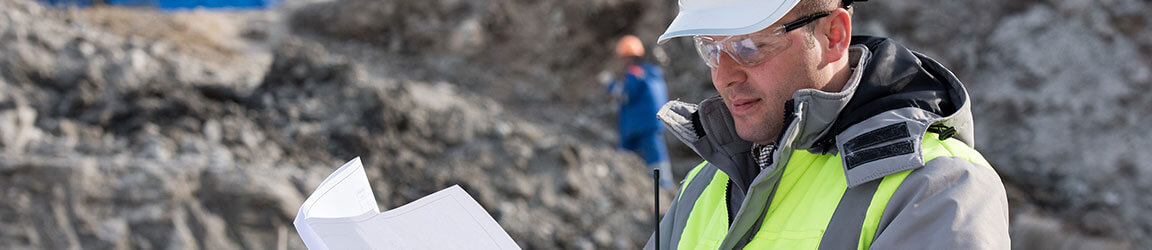 Man wearing hardhat on a worksite