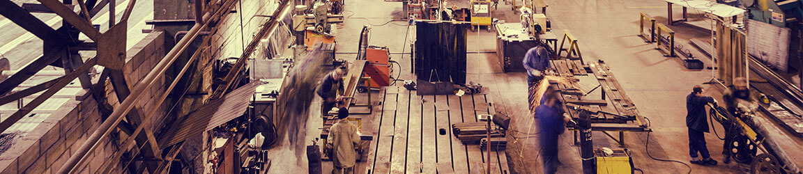Workers assembling on a manufacturing room floor