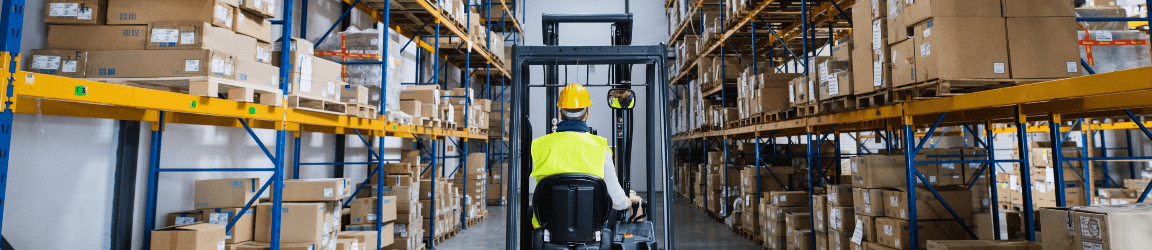 forklift driver inside a warehouse