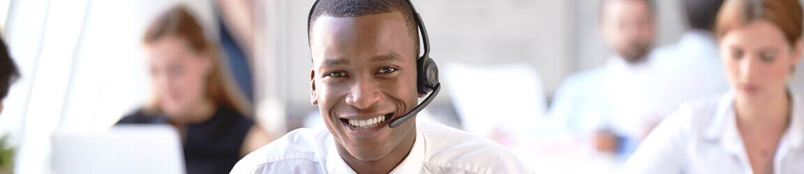 Smiling man working in a call center