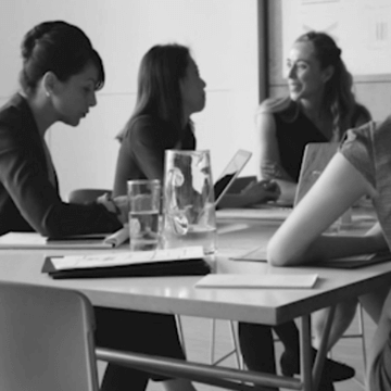 Women working together in a conference space