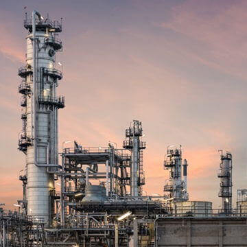 Oil industry refinery plant at sunset