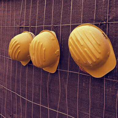 Three yellow hard hats