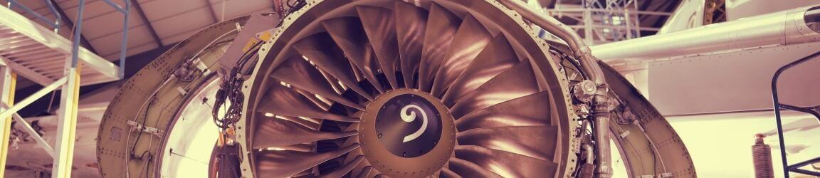 Closeup of airplane engine in a hangar