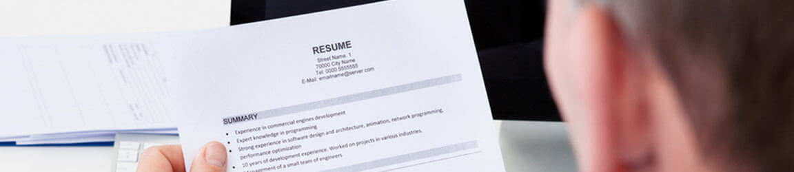 Male reading resume